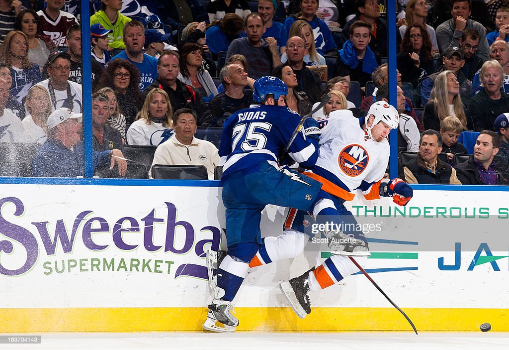 Radko Gudas #75 of the Tampa Bay Lightning checks <a gi-track='captionPersonalityLinkClicked' href=/galleries/search?phrase=Eric+Boulton&family=editorial&specificpeople=217746 ng-click='$event.stopPropagation()'>Eric Boulton</a> #36 of the New York Islanders during the second period of the game at the Tampa Bay Times Forum on March 14, 2013 in Tampa, Florida.