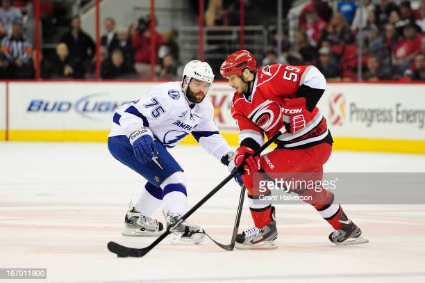 Radko Gudas of the Tampa Bay Lightning defends Chad LaRose of the Carolina Hurricanes during play at PNC Arena on April 4 2013 in Raleigh North...
