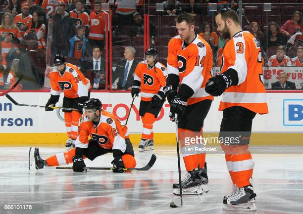 Radko Gudas Sean Couturier Brandon Manning Valtteri Filppula and Colin McDonald of the Philadelphia Flyers warm up prior to their game against the...