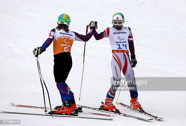 Radomir Dudas of Slovakia reacts with his guide Michal Cerven in the Men's Super G Visually Impaired during day two of Sochi 2014 Paralympic Winter...