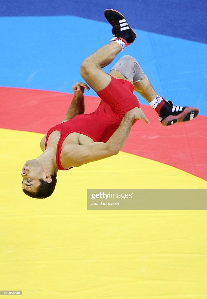 Radoslav Velikov of Bulgaria celebrates by doing a flip after defeating Namig Sevdimov of Azerbaijan in the bronze medal bout during the men's 55kg freestyle wrestling event at the China Agriculture University Gymnasium on Day 11 of the Beijing 2008 Olympic Games on August 19, 2008 in Beijing, China.