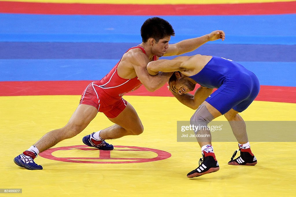 Radoslav Velikov (blue) of Bulgaria competes against Henry Cejudo of the United States in the 55 kg freestyle wrestling event at the China Agriculture University Gymnasium on Day 11 of the Beijing 2008 Olympic Games on August 19, 2008 in Beijing, China.