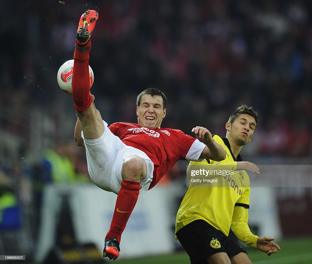 <a gi-track='captionPersonalityLinkClicked' href=/galleries/search?phrase=Radoslav+Zabavnik&family=editorial&specificpeople=2119662 ng-click='$event.stopPropagation()'>Radoslav Zabavnik</a> of Mainz (L) is challenged by <a gi-track='captionPersonalityLinkClicked' href=/galleries/search?phrase=Moritz+Leitner&family=editorial&specificpeople=7118695 ng-click='$event.stopPropagation()'>Moritz Leitner</a> of Dortmund during the Bundesliga match between 1. FSV Mainz 05 and Borussia Dortmund at Coface Arena on November 24, 2012 in Mainz, Germany.