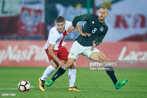 Radoslaw Kanach of U19 Poland fights for the ball with Arne Maier of U19 Germany during soccer match U19 Poland v U19 Germany UEFA Under19 Euro...