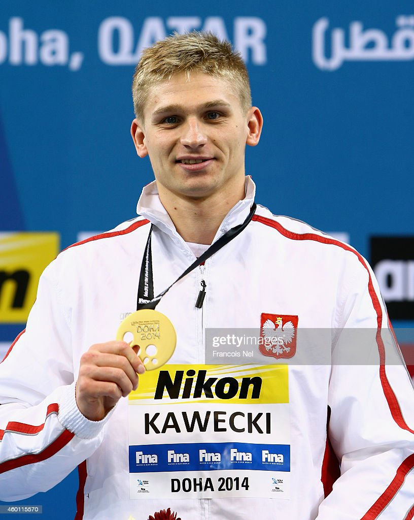 Radoslaw Kawecki of Poland celebrates on the podium after winning the Men's 200m Backstroke Finals during day five of the 12th FINA World Swimming Championships (25m) at the Hamad Aquatic Centre on December 7, 2014 in Doha, Qatar.
