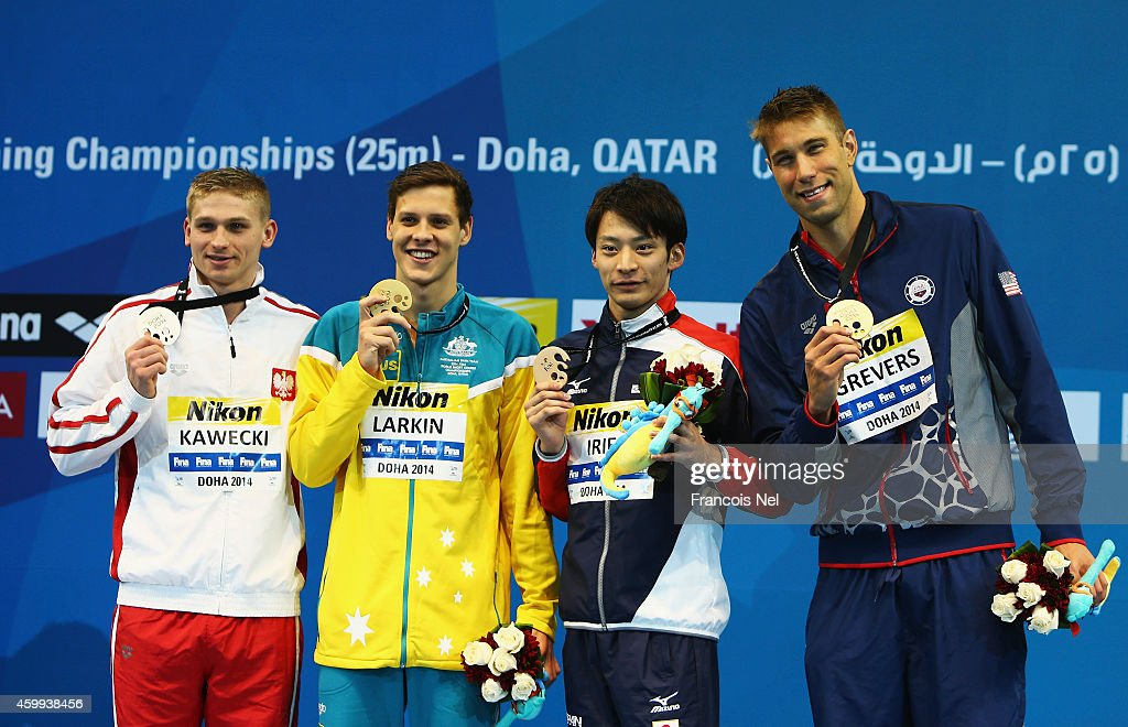 Radoslaw Kawecki of Poland, James Larkin of Australia, <a gi-track='captionPersonalityLinkClicked' href=/galleries/search?phrase=Ryosuke+Irie&family=editorial&specificpeople=4057991 ng-click='$event.stopPropagation()'>Ryosuke Irie</a> of Japan and <a gi-track='captionPersonalityLinkClicked' href=/galleries/search?phrase=Matt+Grevers&family=editorial&specificpeople=2499373 ng-click='$event.stopPropagation()'>Matt Grevers</a> of the USA celebrates on the podium after the Men's 100m Backstroke Final during day two of the 12th FINA World Swimming Championships (25m) at the Hamad Aquatic Centre on December 4, 2014 in Doha, Qatar.