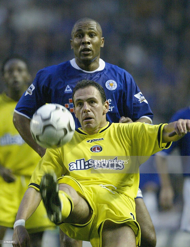Radostin Kishishev of Charlton holds off Les Ferdinand of Leicester during the FA Barclaycard Premiership match between Leicester City and Charlton Athletic at Walkers Stadium on November 22, 2003 in Leicester, England.