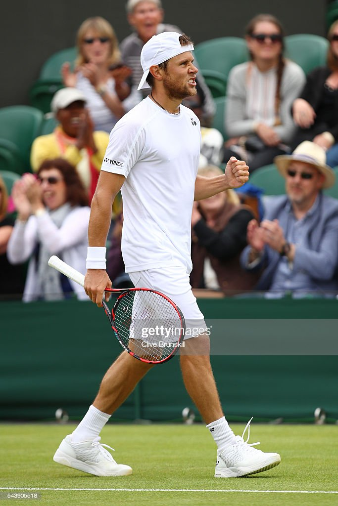 Radu Albot of Moldova celebrates during the Men's Singles second round match against Bernard Tomic of Australia on day four of the Wimbledon Lawn Tennis Championships at the All England Lawn Tennis and Croquet Club on June 30, 2016 in London, England.
