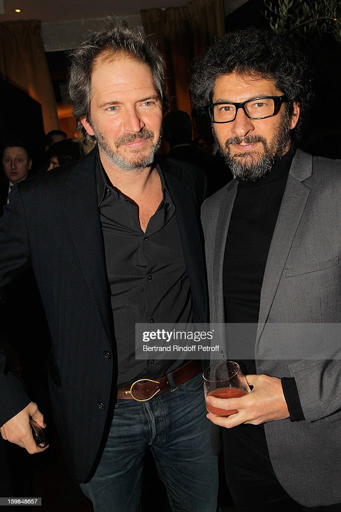 Radu Mihaileanu (R) and Christopher Thompson attend 'La Petite Maison De Nicole' Inauguration Cocktail at Hotel Fouquet's Barriere on January 21, 2013 in Paris, France.