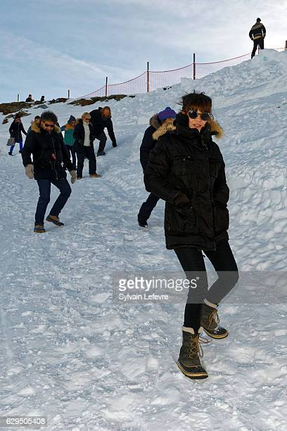 Radu Mihaileanu and Melanie Doutey walk in the snow as guests and participants of the 'Les Arcs' European Film Festival are invited to have a french...