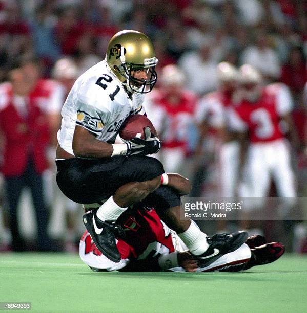 Rae Carruth of the Universty of Colorado Buffaloes catches a pass during a game against the University of Wisconsin Badgers in 1995 in Madison...