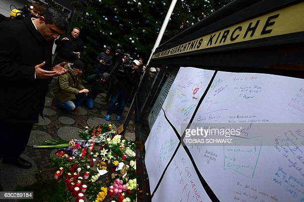 Raed Saleh Chairman of the SPD group in the Berlin's parliament prays in front at the KaiserWilhelmGedaechtniskirche the day after an attack at the...