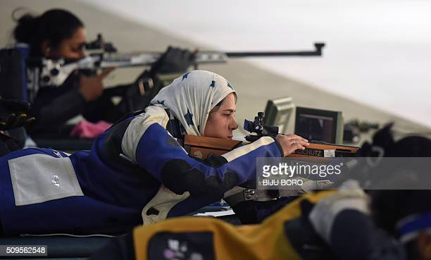 TOPSHOT Raees Nadira of Pakistan prepares to shoot as she takes part in the final of the 50m free rifle event at a shooting range in Guwahati at the...
