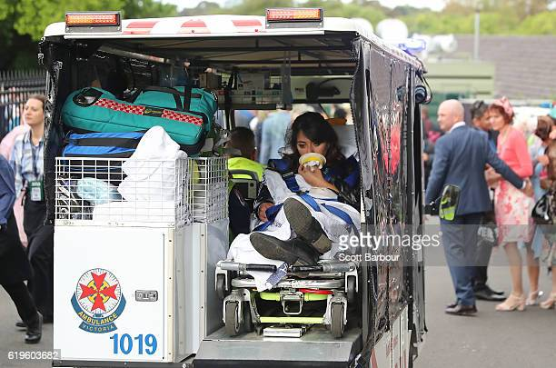 A raegoer is transported in the back of an ambulance following 2016 Melbourne Cup Day at Flemington Racecourse on November 1 2016 in Melbourne...