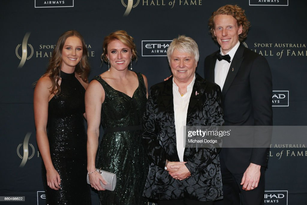 Raelene Boyle is flanked by rising Andre Russell of the Thunder track and field athlete Riley Day (L) World and Olympics Champion hurdler Sally Pearson and Olympic polevault champion Steve Hooker after being announced The Legend inductee at the Sport Australia Hall of Fame Annual Induction and Awards Gala Dinner at Crown Palladium on October 12, 2017 in Melbourne, Australia.