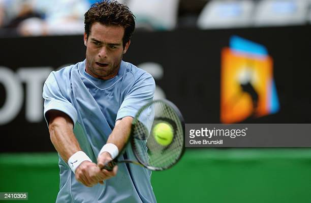 Raemon Sluiter of The Netherlands hits a shot against Marat Safin of Russia during the Australian Open Tennis Championships at Melbourne Park on...