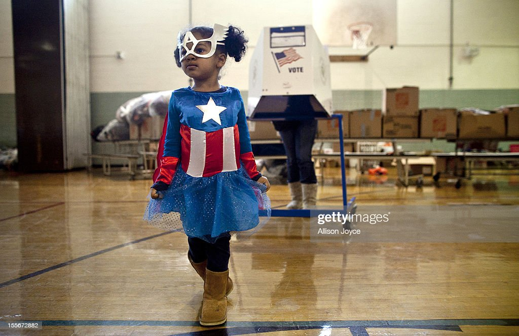 Raena Lamont, 3, wears a Captain America at a polling center doubling as a donation site November 6, 2012 in the Staten Island borough of New York City. As Staten Island continues to recover from Superstorm Sandy, a few polling stations have been relocated due to power outages or ongoing use as an evacuation center.