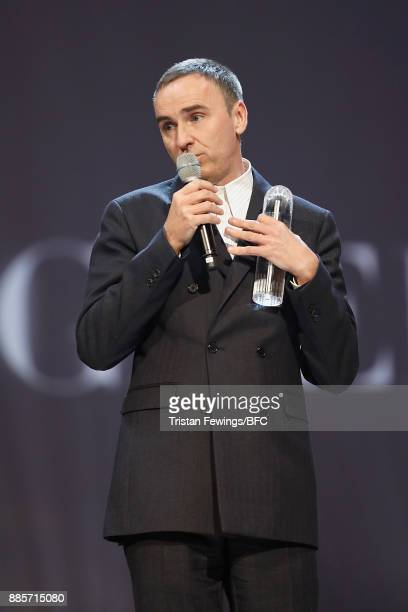 Raf Simons accepts his award during The Fashion Awards 2017 in partnership with Swarovski at Royal Albert Hall on December 4 2017 in London England