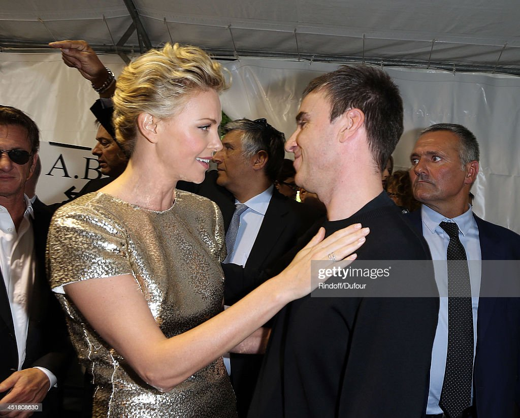 Raf Simons and Charlize Theron attend in backstage the Christian Dior show as part of Paris Fashion Week - Haute Couture Fall/Winter 2014-2015 at Muse Rodin on July 7, 2014 in Paris, France.