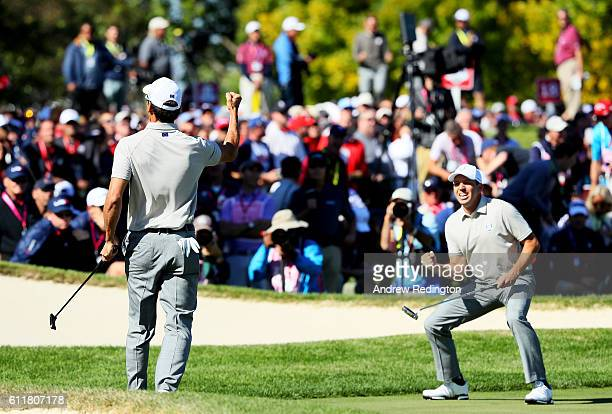 Rafa Cabrera Bello and Sergio Garcia of Europe react to a putt on the 17th green during morning foursome matches of the 2016 Ryder Cup at Hazeltine...