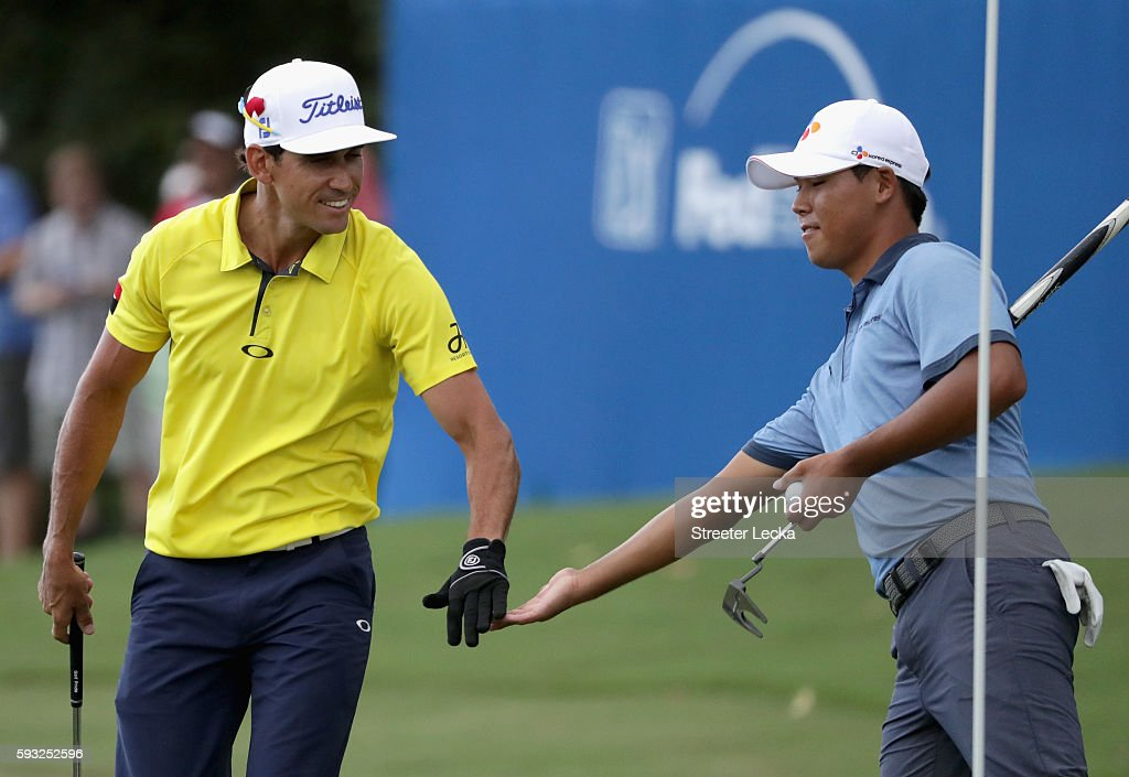Rafa Cabrera Bello celebrates after making a shot on the 15th hole with Si Woo Kim during the final round of the Wyndham Championship at Sedgefield...