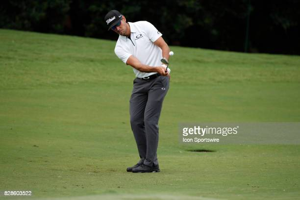 Rafa Cabrera Bello chips on the 13th hole during the third practice round of the PGA Championship on August 9 2017 at Quail Hollow Club in Charlotte...