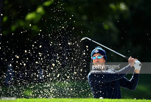Rafa Cabrera Bello of Europe hits out of a bunker on the fifth hole while practicing prior to the 2016 Ryder Cup at Hazeltine National Golf Club on...