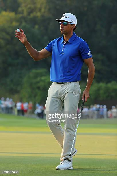 Rafa Cabrera Bello of Spain acknowledges the crowd on the 18th green during the third round of the UBS Hong Kong Open at The Hong Kong Golf Club on...