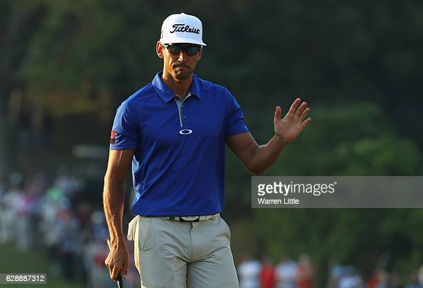 Rafa Cabrera Bello of Spain celebrates a birdie on the 18th green during the third round of the UBS Hong Kong Open at The Hong Kong Golf Club on...
