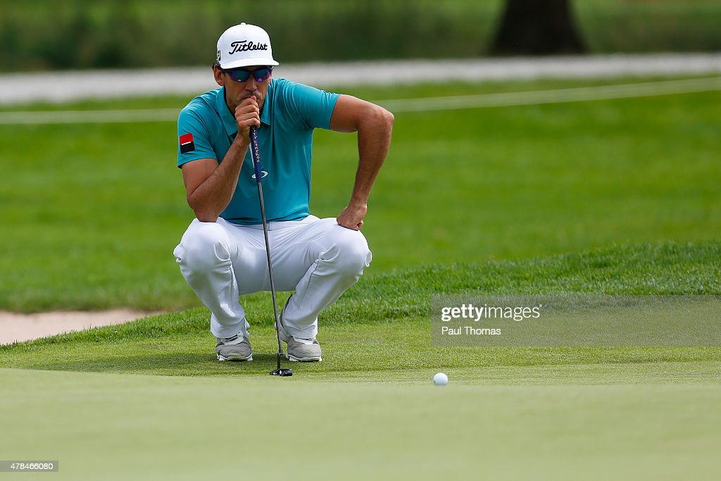 Rafa Cabrera Bello of Spain linesup a putt during the BMW International Open day one at the Eichenried Golf Club on June 25 2015 in Munich Germany