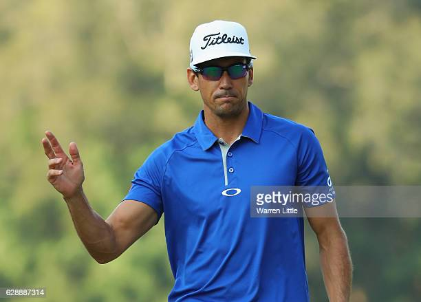Rafa Cabrera Bello of Spain makes a birdie putt on the 15th green during the third round of the UBS Hong Kong Open at The Hong Kong Golf Club on...