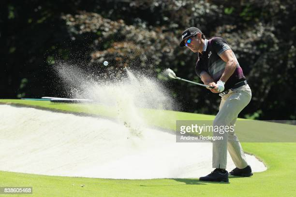 Rafa Cabrera Bello of Spain plays a shot from a bunker on the ninth hole during round one of The Northern Trust at Glen Oaks Club on August 24 2017...