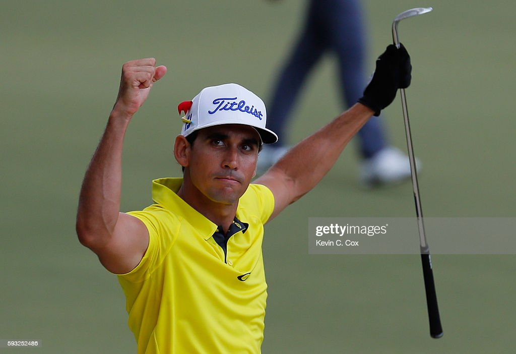 Rafa Cabrera Bello of Spain reacts after chipping in for eagle on the 15th hole during the final round of the Wyndham Championship at Sedgefield...