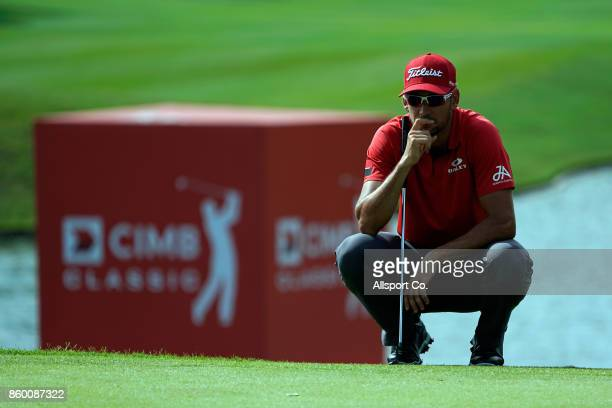Rafa Cabrera Bello of Spain waits for his turn to putt on the 9th hole during the Pro Am ahead of the 2017 CIMB Classic at TPC Kuala Lumpur on...