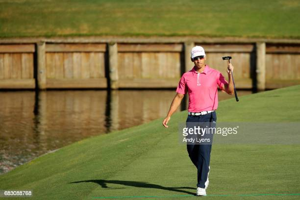 Rafa Cabrera Bello of Spain waves to the crowd on the 17th hole during the final round of THE PLAYERS Championship at the Stadium course at TPC...