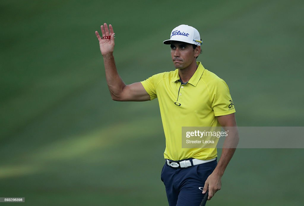 Rafa Cabrera Bello waves to the crowd on the 18th hole during the final round of the Wyndham Championship at Sedgefield Country Club on August 21...