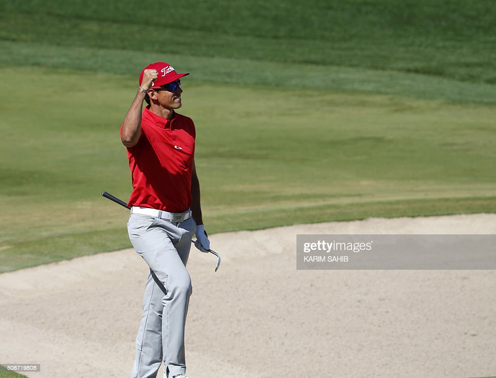 Rafa Cabrera-Bello of Spain celebrates holing his bunker for eagle shot during the third round of the 2016 Dubai Desert Classic at the Emirates Golf Club in Dubai on February 6, 2016. / AFP / KARIM SAHIB