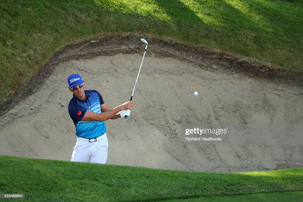 Rafa Cabrera-Bello of Spain hits from a bunker on the 18th hole during day one of the BMW PGA Championship at Wentworth on May 26, 2016 in Virginia Water, England.