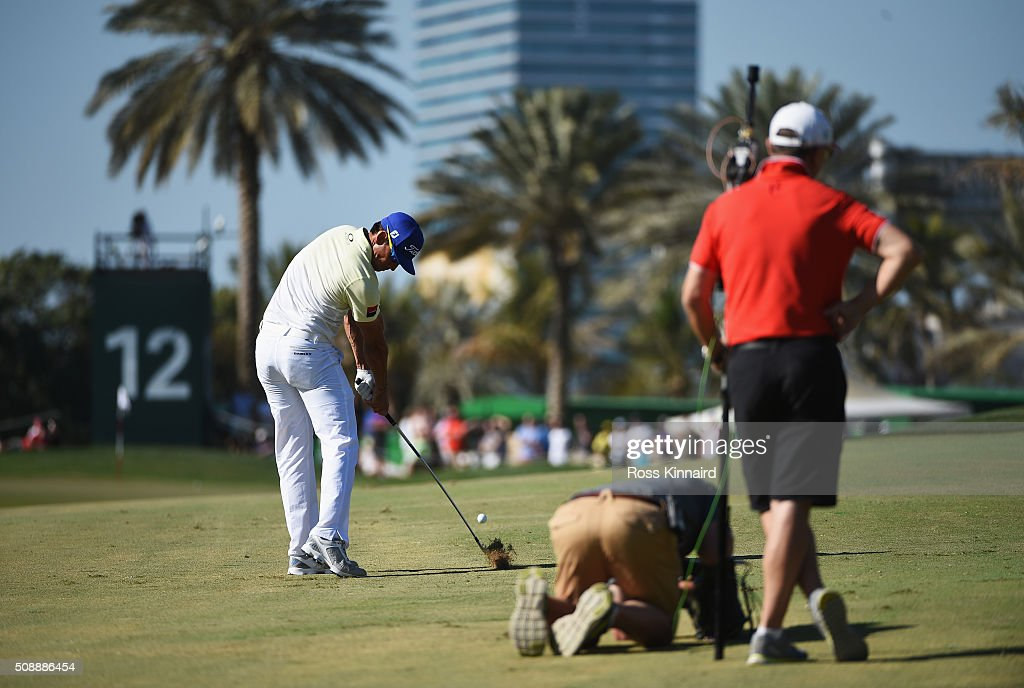 Rafa Cabrera-Bello of Spain hits his second shot on the 12th hole during the final round of the Omega Dubai Desert Classic at the Emirates Golf Club on February 7, 2016 in Dubai, United Arab Emirates.