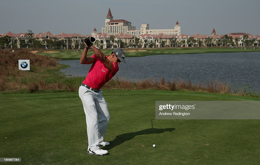 Rafa Cabrera-Bello of Spain hits his tee-shot on the ninth hole during the final round of the BMW Masters at Lake Malaren Golf Club on October 27, 2013 in Shanghai, China.