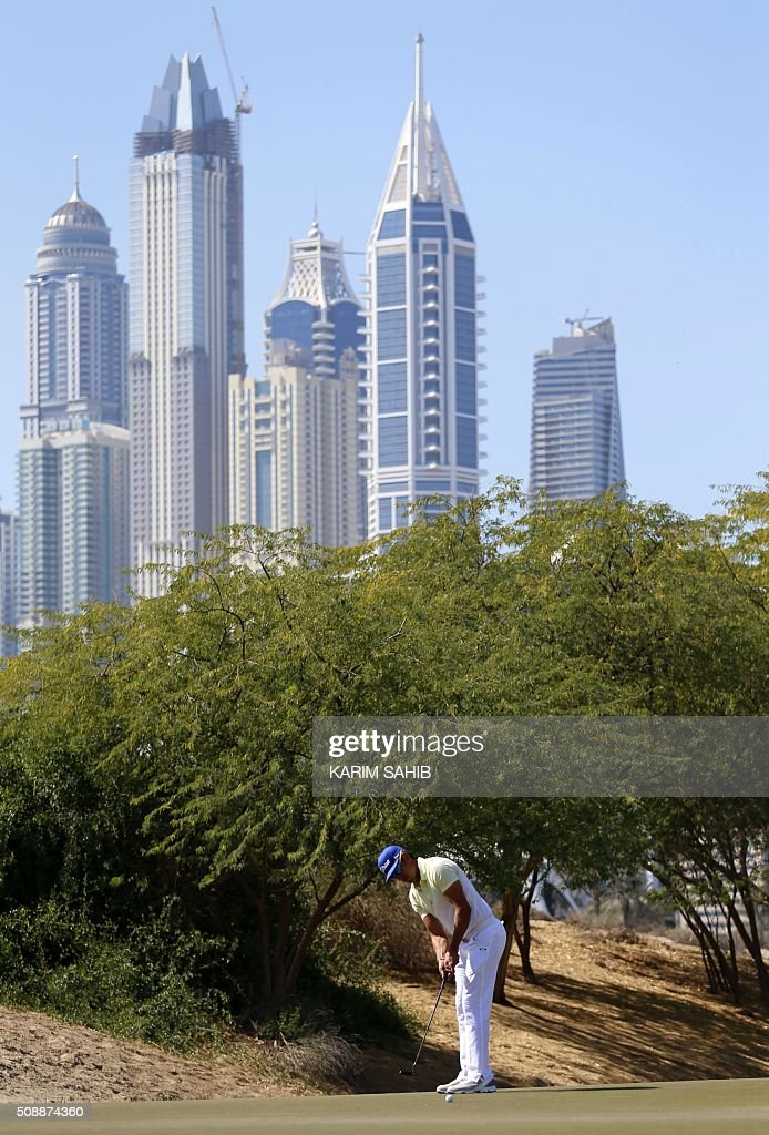 Rafa Cabrera-Bello of Spain plays a shot during the final round of the 2016 Dubai Desert Classic at the Emirates Golf Club in Dubai on February 7, 2016. SAHIB
