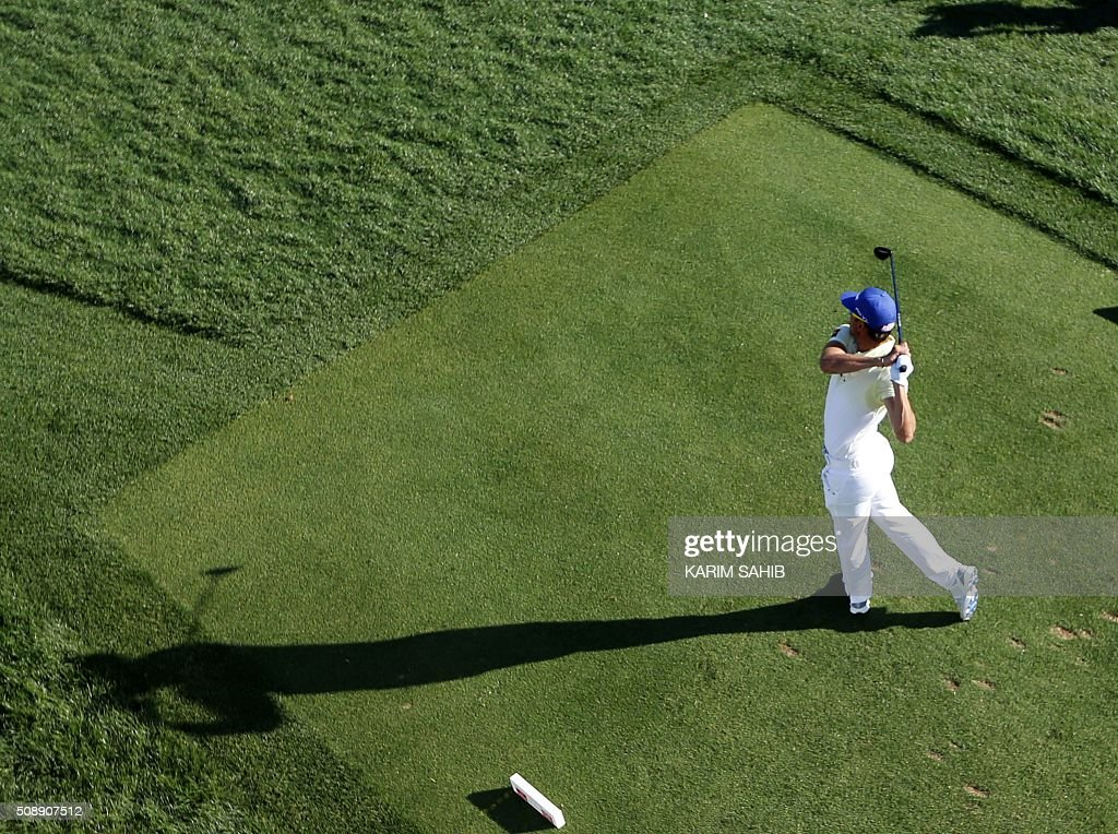 Rafa Cabrera-Bello of Spain plays a shot during the final round of the 2016 Dubai Desert Classic at the Emirates Golf Club in Dubai on February 7, 2016. Willett made a pressure-packed 15-feet birdie putt on the 18th hole to win the Dubai Desert Classic by one shot over Englands Andy Sullivan and Spains Rafael Cabrera-Bello. SAHIB