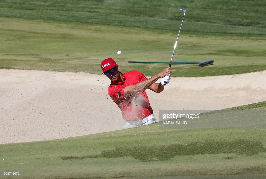 Rafa Cabrera-Bello of Spain plays a shot during the third round of the 2016 Dubai Desert Classic at the Emirates Golf Club in Dubai on February 6, 2016. / AFP / KARIM SAHIB