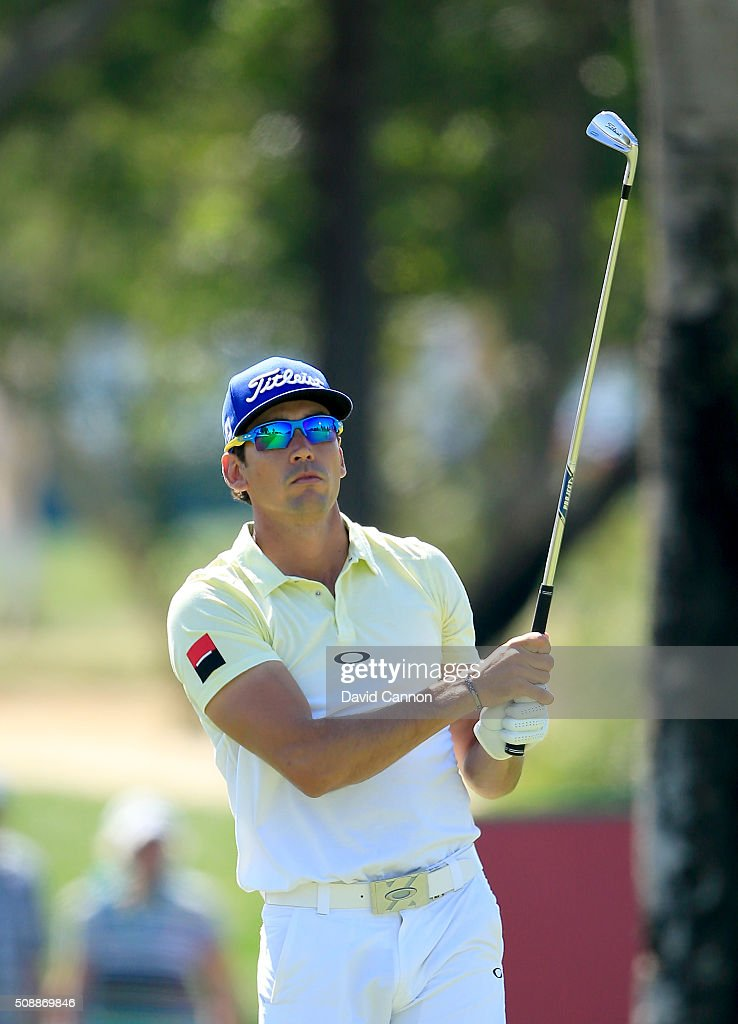 Rafa Cabrera-Bello of Spain plays his second shot at the par 4, first hole during the final round of the 2016 Omega Dubai Desert Classic on the Majlis Course at the Emirates Golf Club on February 7, 2016 in Dubai, United Arab Emirates.