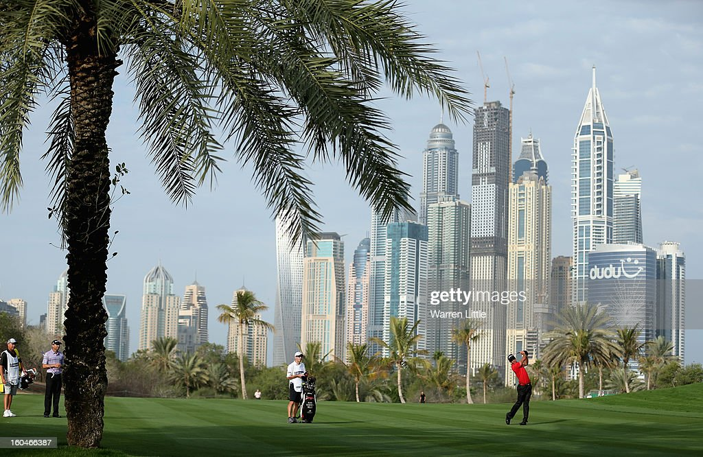 Rafa Cabrera-Bello of Spain plays his second shot into the 13th green during the second round of the Omega Dubai Desert Classic at Emirates Golf Club on February 1, 2013 in Dubai, United Arab Emirates.