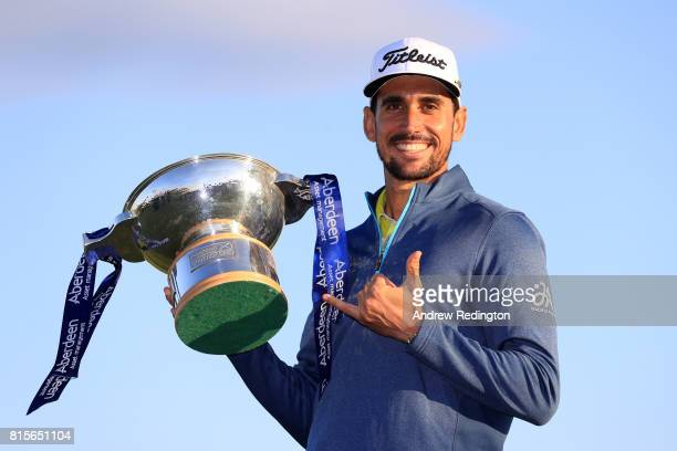 Rafa CabreraBello of Spain poses with the trophy following his victory on the 1st play off hole during the final round of the AAM Scottish Open at...