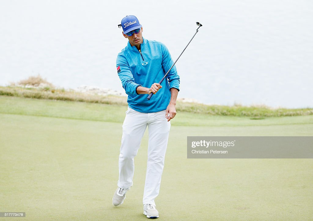 Rafa CabreraBello of Spain reacts to a missd putt on the 11th green during his semifinal match with Louis Oosthuizen at the World Golf...