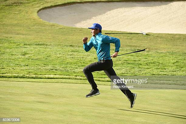 Rafa CabreraBello of Spain runs up to the green during the Guiness World Record attempt at the fastest par five hole of 500 yards prior to the Open...