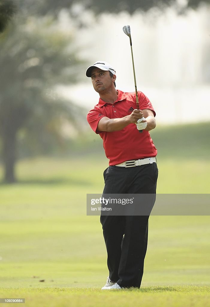 Rafa Echenique of Argentina hits an iron shot during the third round of the Avantha Masters held at The DLF Golf and Country Club on February 19 2011...