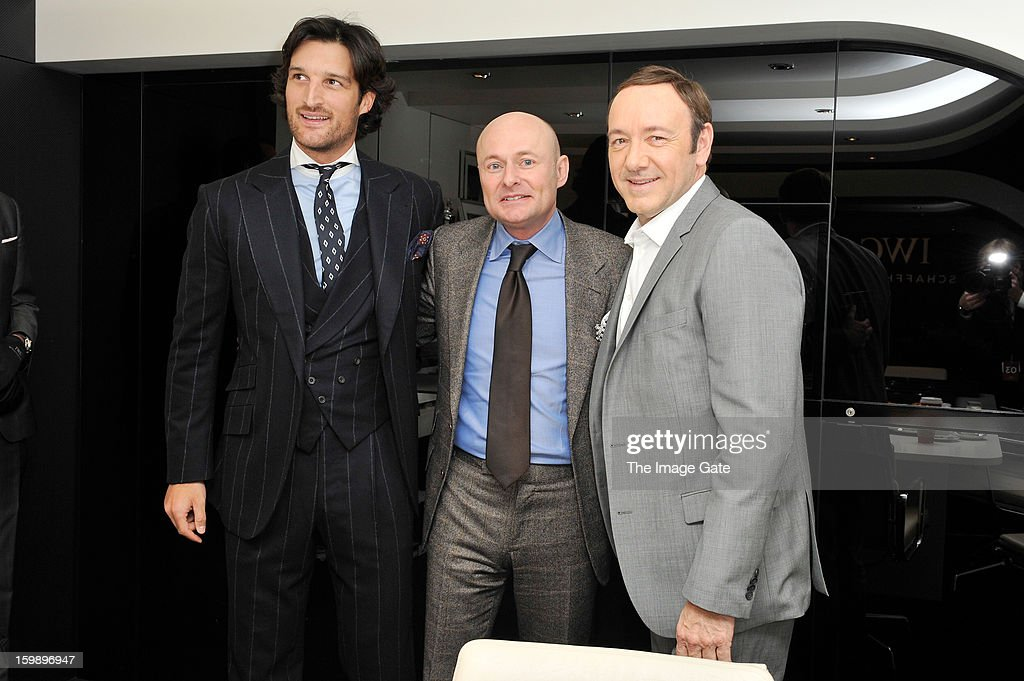 Rafa Medina, Georges Kern and <a gi-track='captionPersonalityLinkClicked' href=/galleries/search?phrase=Kevin+Spacey&family=editorial&specificpeople=202091 ng-click='$event.stopPropagation()'>Kevin Spacey</a> visit the IWC booth during the Salon International de la Haute Horlogerie (SIHH) 2013 at Palexpo on January 22, 2013 in Geneva, Switzerland.